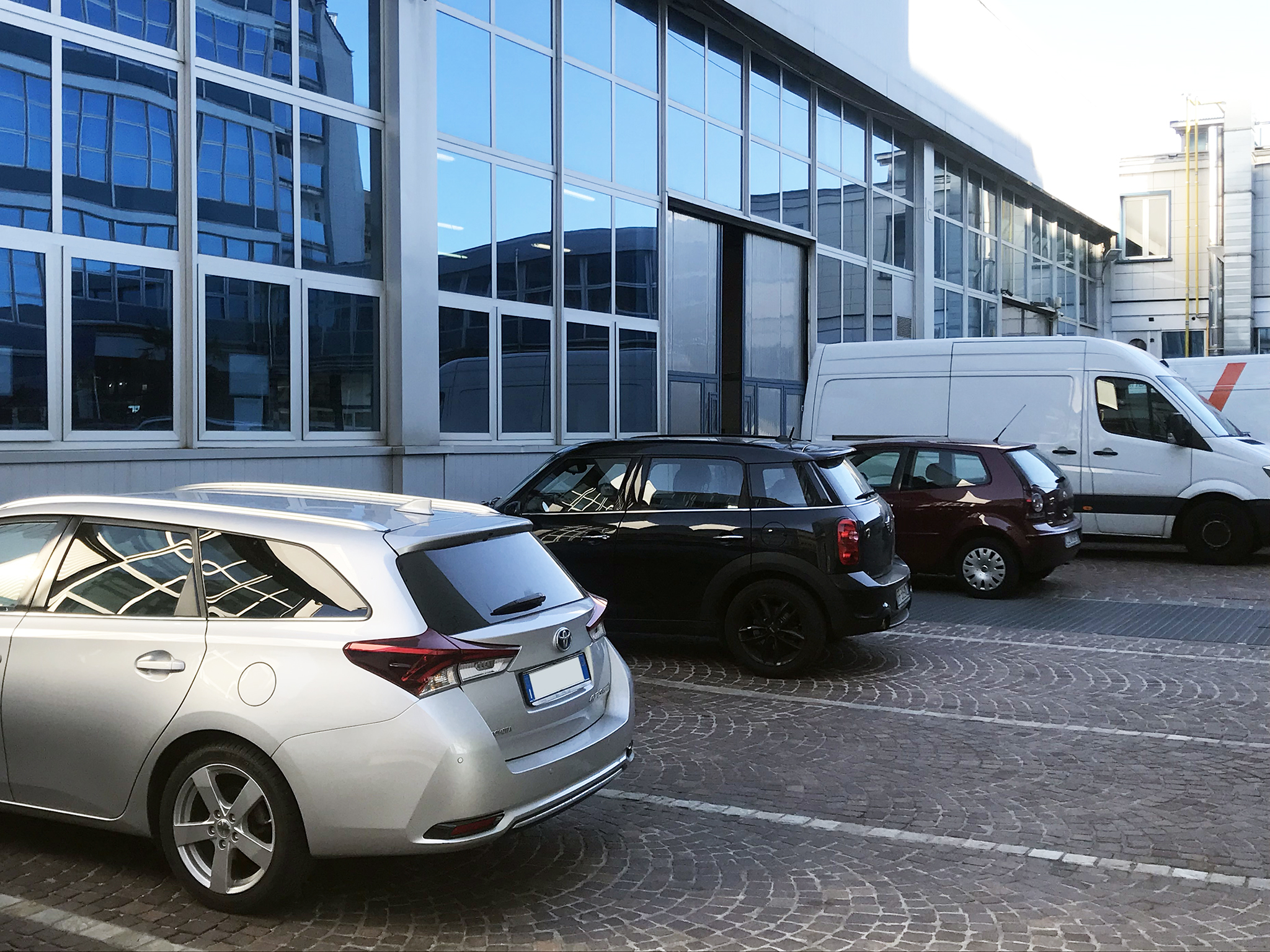 Outdoor parking spaces in the main courtyard
