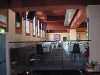 mezzanine tables of self service restaurant in in Atlantic Business Center Milan